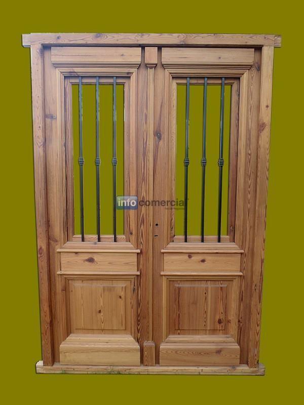 Puerta de entrada frente doble hoja en madera for Puerta doble madera
